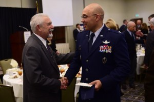 Aurora City Manager Skip Noe and Colonel David Miller shake hands after the State of the Base Luncheon. During the luncheon, Colonel Miller reviewed the base's accomplishments for 2016 and a preview of initiatives for 2017.
